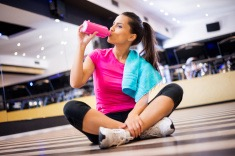 stock-photo-55156158-woman-in-the-gym-hydrating
